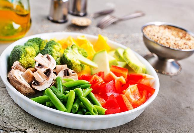 raw vegetables for baking, vegetables and mushrooms on plate. healthy vegetable heavy diet for gut health