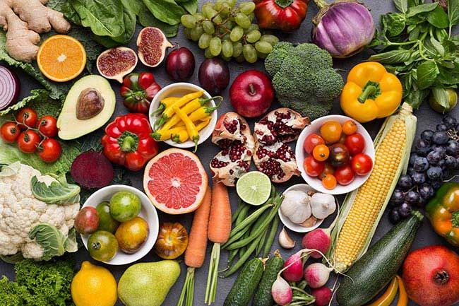 Healthy food background. Assorted fresh ripe fruits and vegetables, top view