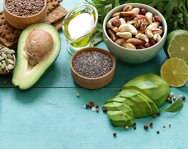 healthy food assortment:avocados, tree nuts, olive oil, pumpkin seeds