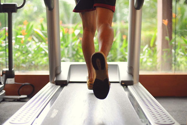 man exercising on the treadmill. increasing blood flow and promoting seat is good for the body.