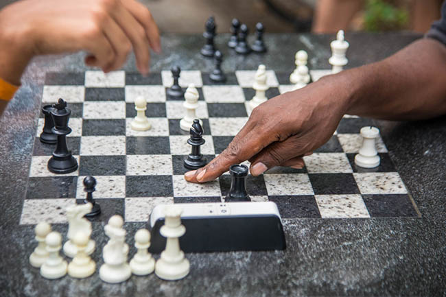 Playing chess in the park. Exercise can benefit cognitive skills.