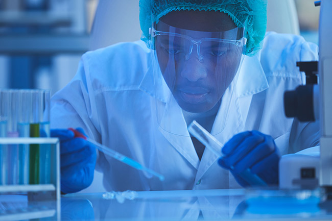 Horizontal close up portrait of young male laboratory scientist working on vaccine effective against new virus